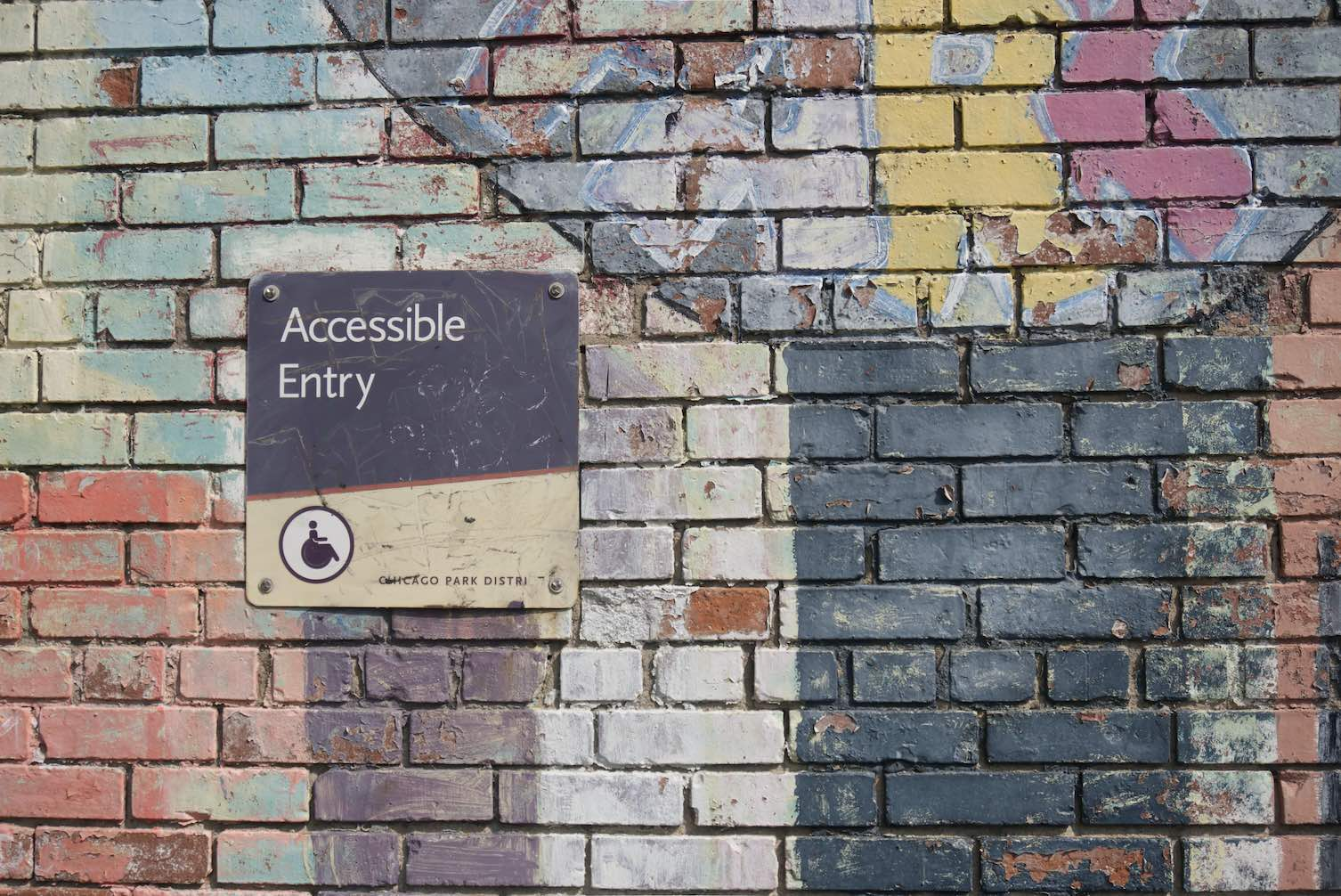 Accessible Entry Sign on a brick wall